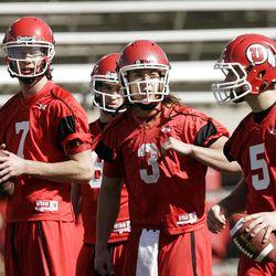 Utah Utes  quarterbacks  Travis Wilson (7),  Jon Hays (9), Jordan Wynn (3) and Chase Hansen (5) throw  in the first spring football practice in Salt Lake City  Tuesday, March 20, 2012.