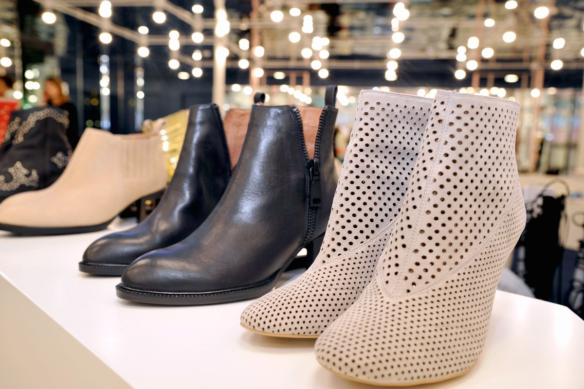 Two pairs of booties, one white, one black.