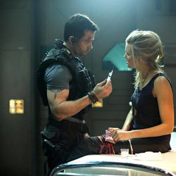 """In this film image released by Film District, Guy Pearce, left, and Maggie Grace are shown in a scene from """"Lockout."""""""