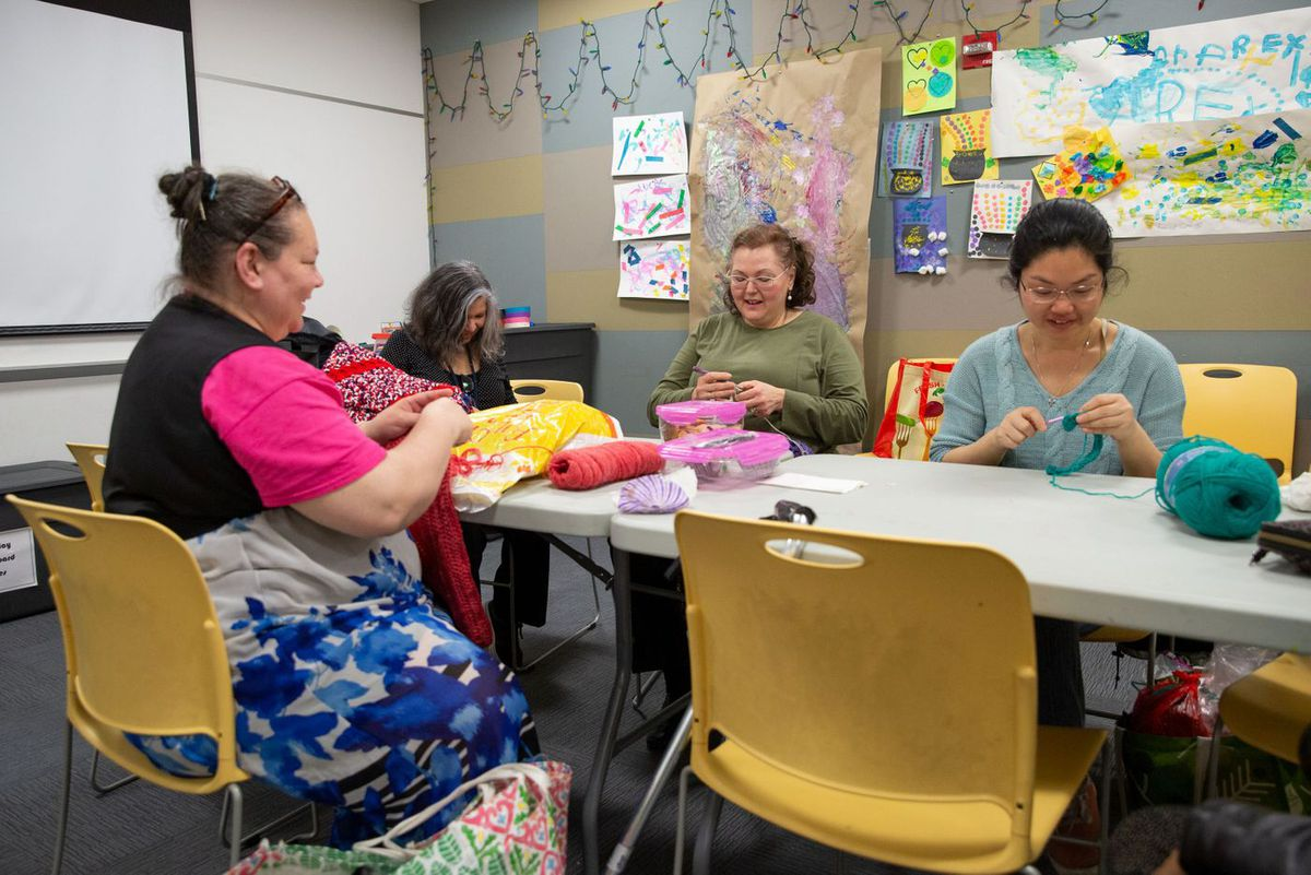 A knitting group meets in the community room of the Queens Library at Court Square, April 23, 2019.