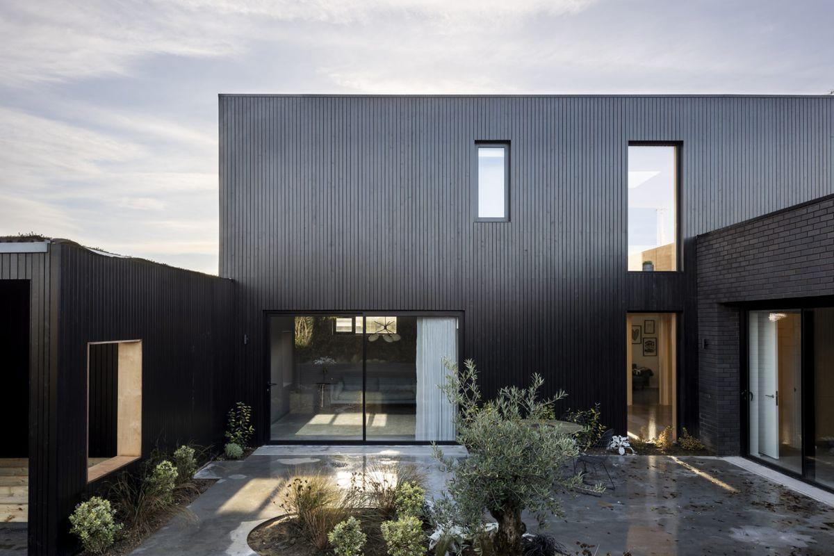 House with black facade.