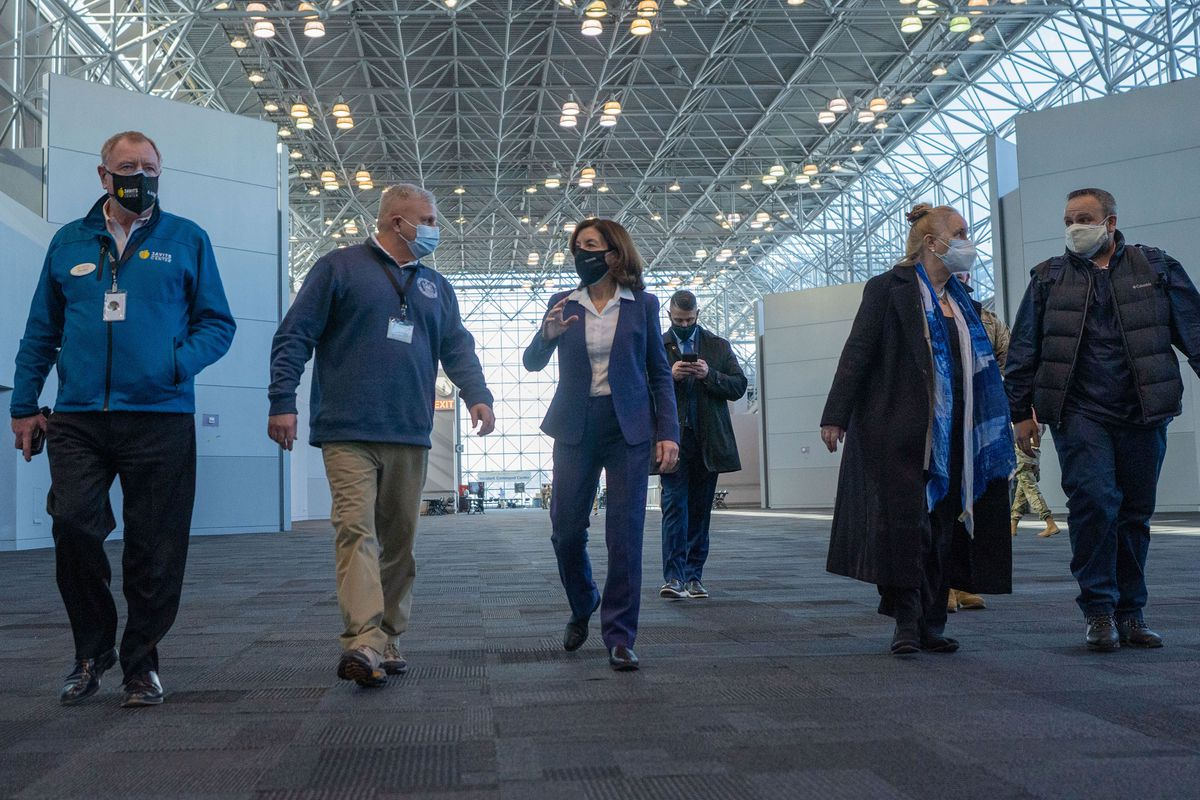 Then Lt. Gov. Kathy Hochul is escorted through the vaccination site by Michael Kopy, assigned to the New York State Department of Health and Alan Steel, executive direct of the Jacob K Javits Convention Center, February 10, 2021