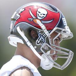 Mike Evans displays the Buccaneers' bold new helmet in rookie mini-camp.