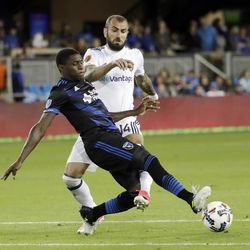 San Jose Earthquakes defender Kofi Sarkodie, front, defends a shot by Real Salt Lake forward Yura Movsisyan during the second half of an MLS soccer match Saturday, June 24, 2017, in San Jose, Calif. (AP Photo/Marcio Jose Sanchez)