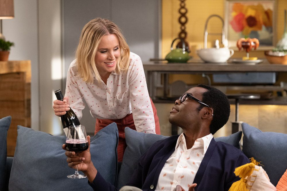 """Eleanor (Kristen Bell) and Chidi (William Jackson Harper) share a bottle of wine in a screenshot from The Good Place season 4, episode 13, """"Whenever You're Ready"""""""