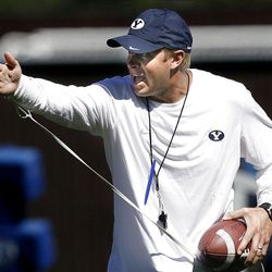 BYU football coach Bronco Mendenhall works with the defense during practice on Wednesday, August 10, 2011.