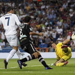 Real Madrid's Cristiano Ronaldo from Portugal, left, scores his second goal during a Spanish La Liga soccer match against Granada at the Santiago Bernabeu stadium in Madrid, Spain, Sunday, Sept. 2, 2012.