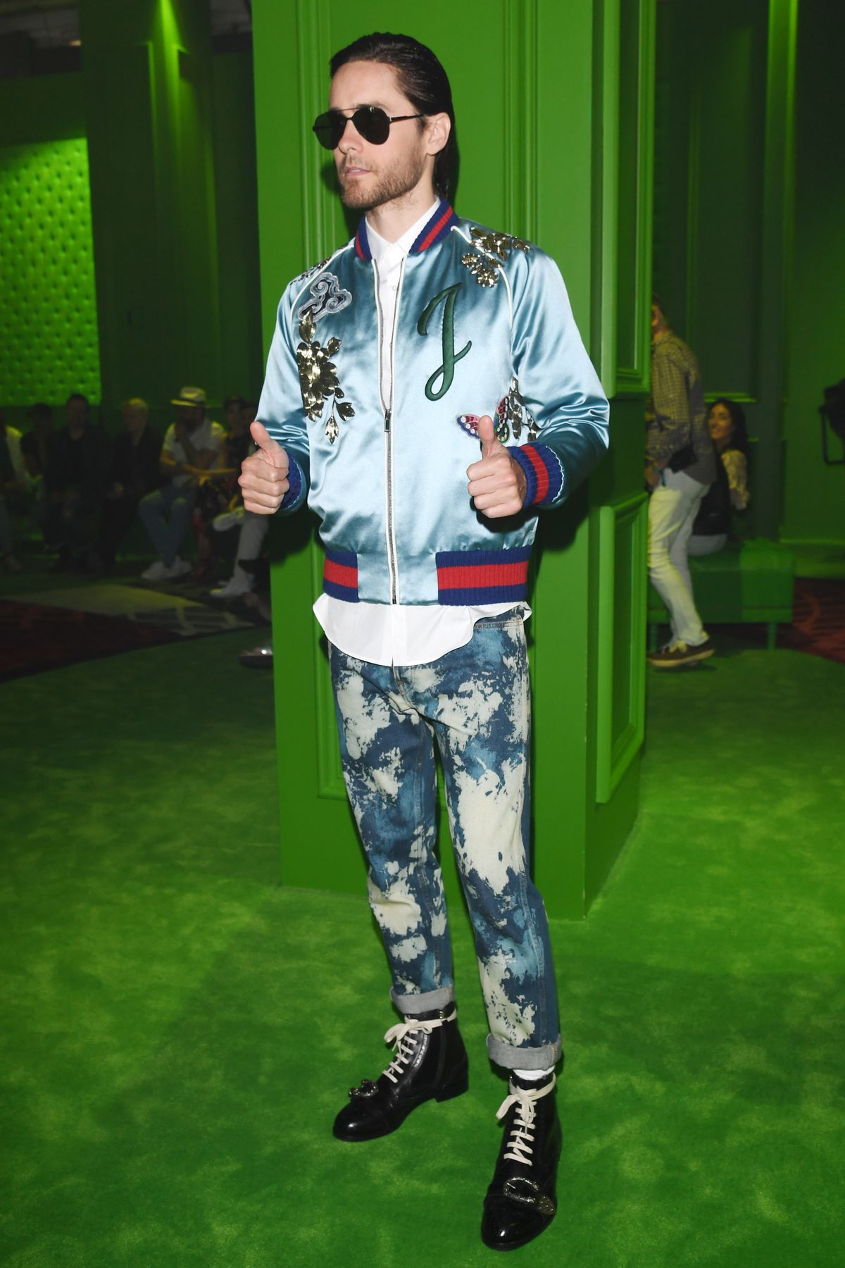Jared Leto wears a customized Gucci bomber at the brand's menswear show in Milan on Monday.