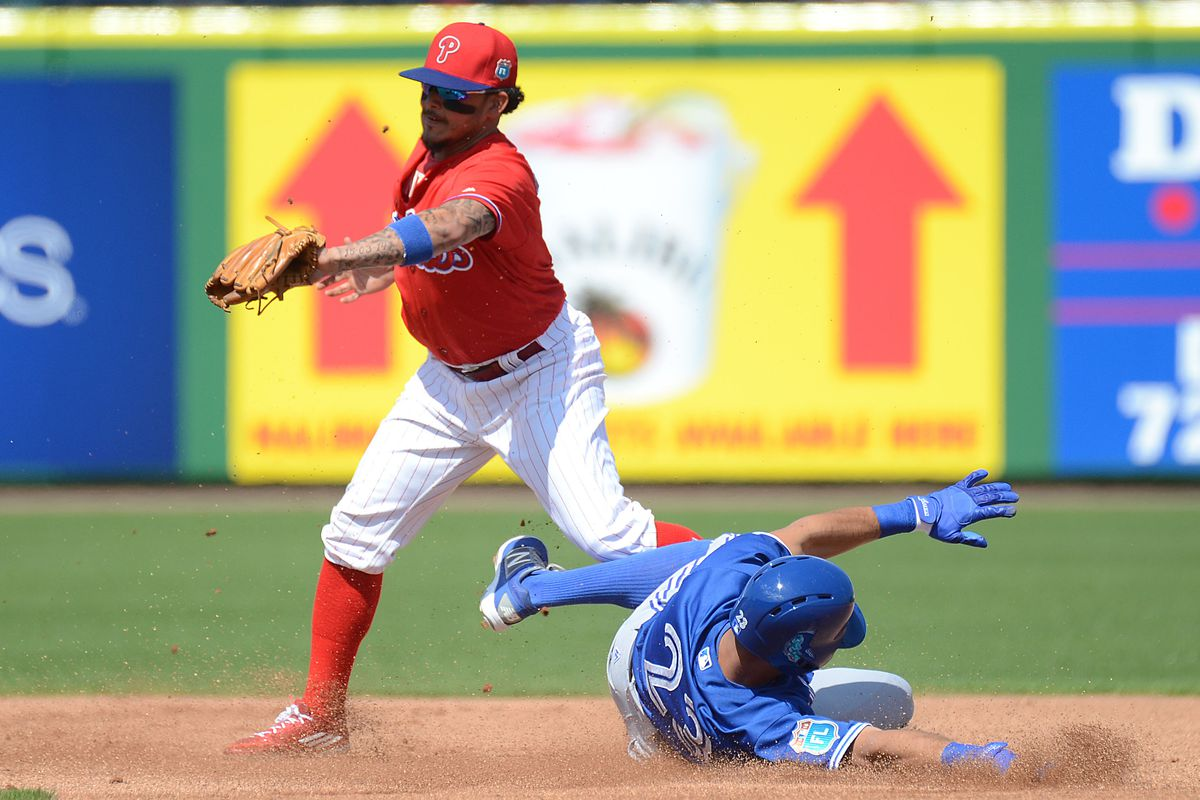 Pompey sliding into second. If he slid with straight legs, at the base, I think he would have been safe.