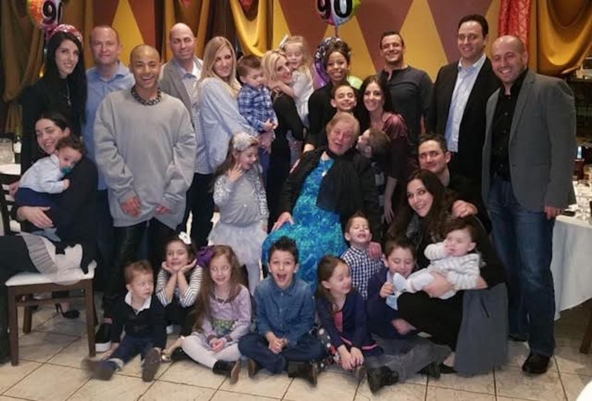 Emilia Pontarelli surrounded by family at her 90th birthday celebration.