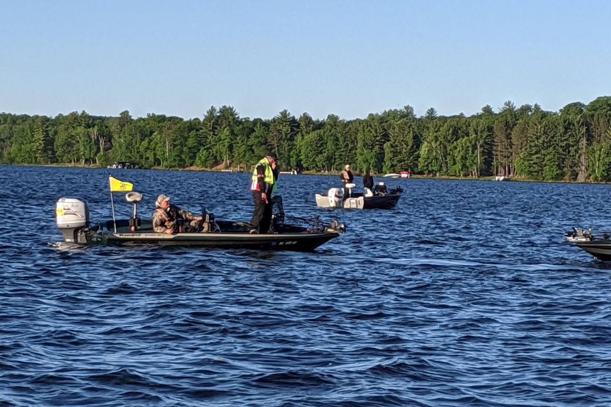 The check-in with a boat, rather than by a dock with coffee and donuts, was part of a much different Spring Classic, the annual muskie tournament on the Eagle River chain in northern Wisconsin put on by the Headwaters chapter of Muskies, Inc. Credit: Dale Bowman