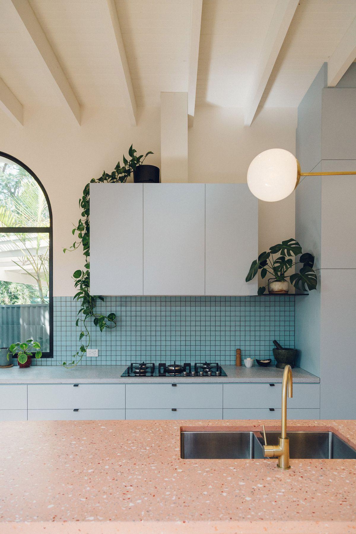 Kitchen with blue backsplash