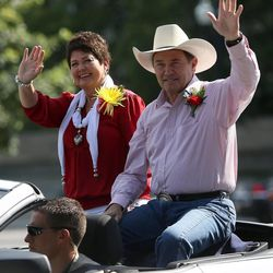 Gov. Gary R. Herbert and his wife Jeanette ride in the Days of '47 Youth Parade in Salt Lake City on Saturday, July 20, 2013.