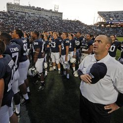 Penn State head coach Bill O'Brien, right foreground, stands with his team as they join the Penn State student section in singing the alma mater following a 24-13 win over Temple in an NCAA college football game in State College, Pa., Saturday, Sept. 22, 2012.