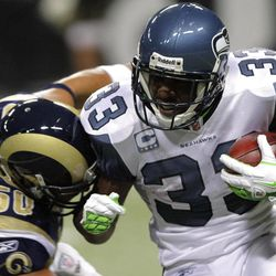 Seattle Seahawks running back Leon Washington (33) runs with the ball against St. Louis Rams linebacker Bryan Kehl (50) during the first quarter of the NFL football, Sunday, Nov. 20, 2011, in St. Louis.