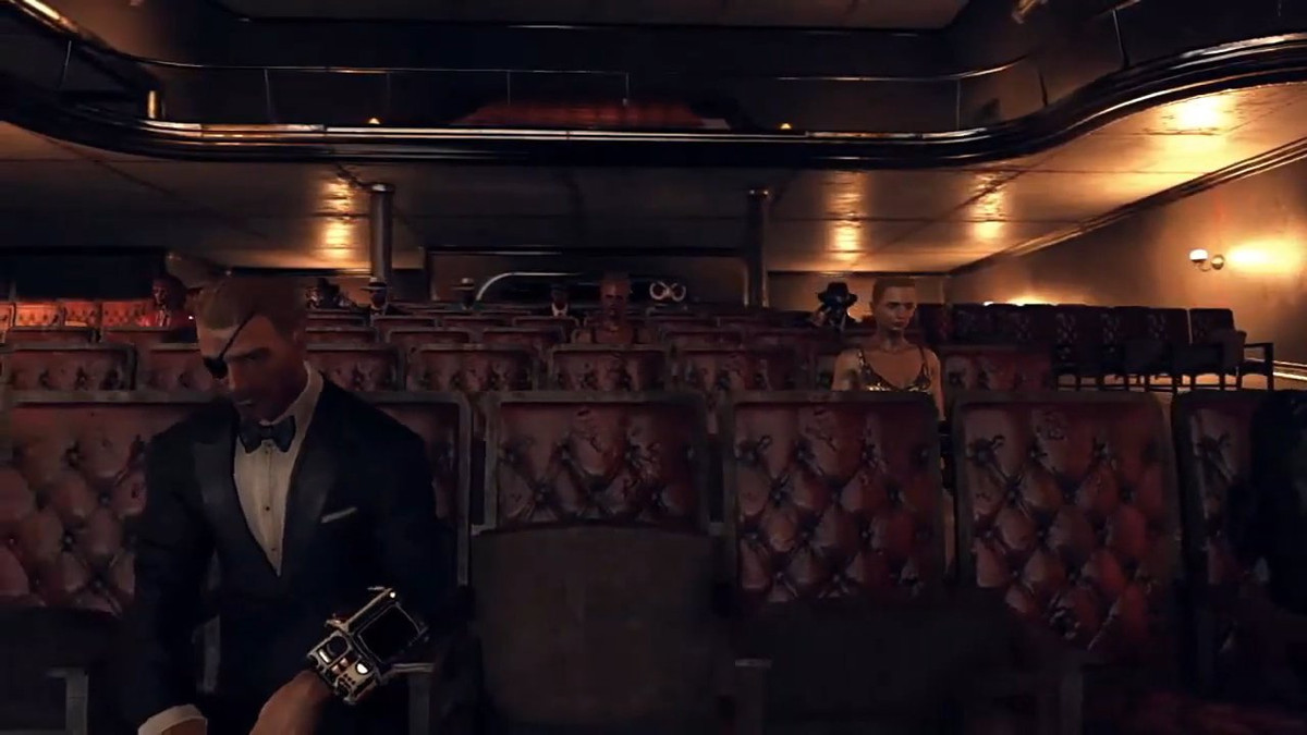 Fallout 76 - a man sits in a movie theater, wearing a fancy tuxedo.