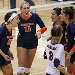 Brighton's Savannah Cottam, London Lindquist and teammates celebrate a point over Skyline in Salt Lake City on Tuesday, Sept. 14, 2021.