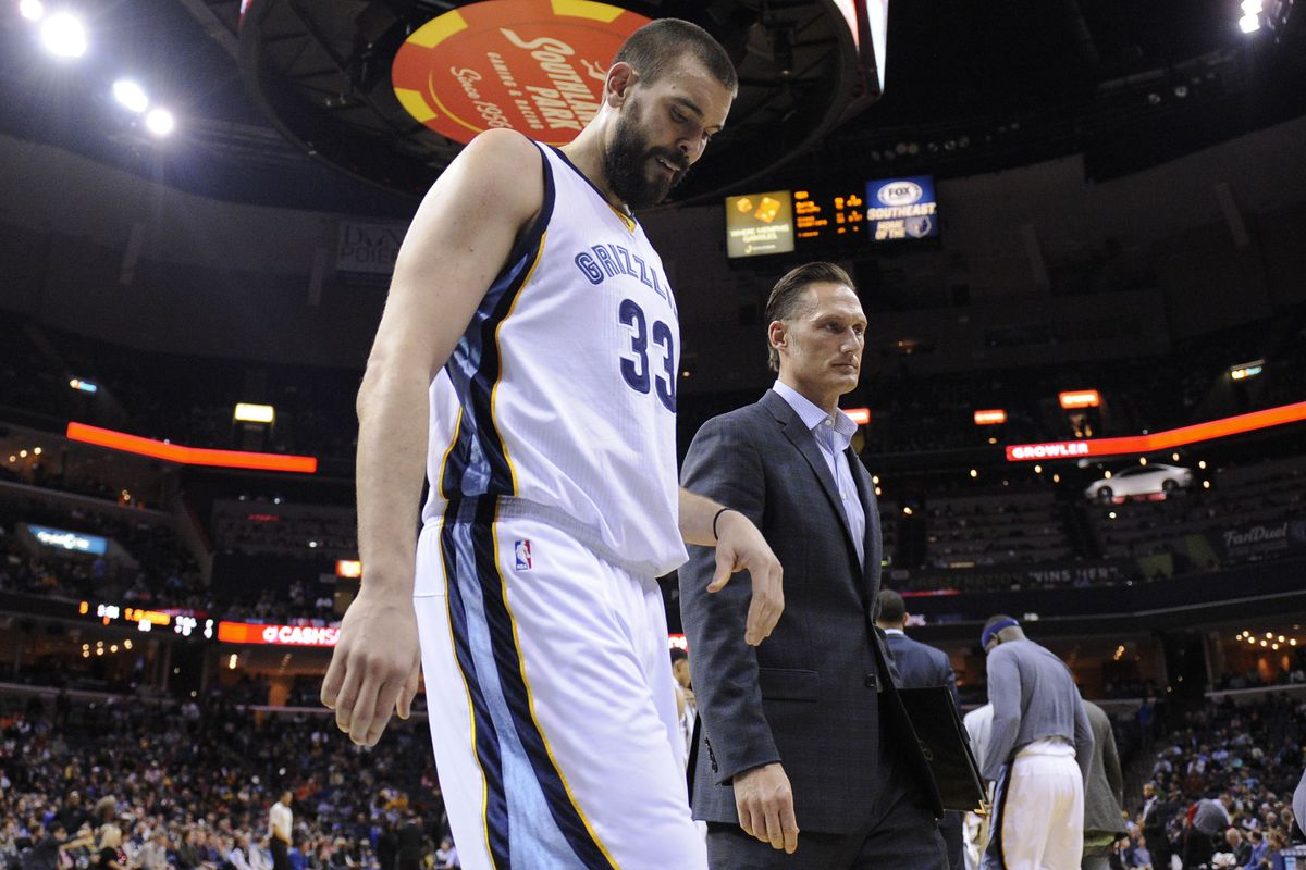 Marc Gasol walking off the court with the Grizzlies trainer after sustaining a foot injury (fracture).