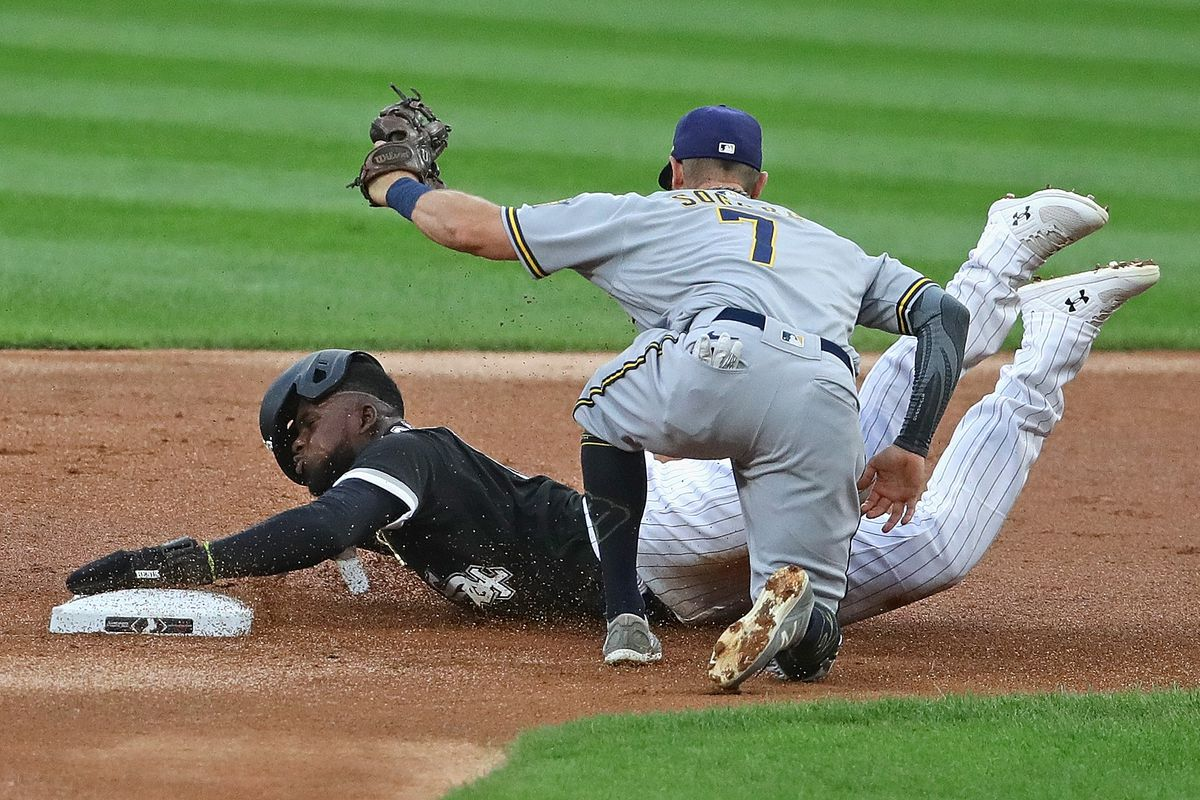 The White Sox Luis Robert is caught stealing at second base by Eric Sogard of the Brewers.