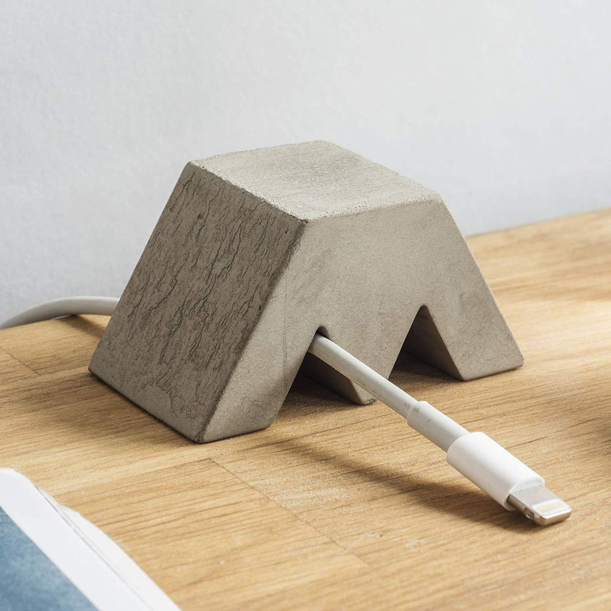 M-shaped concrete volume.