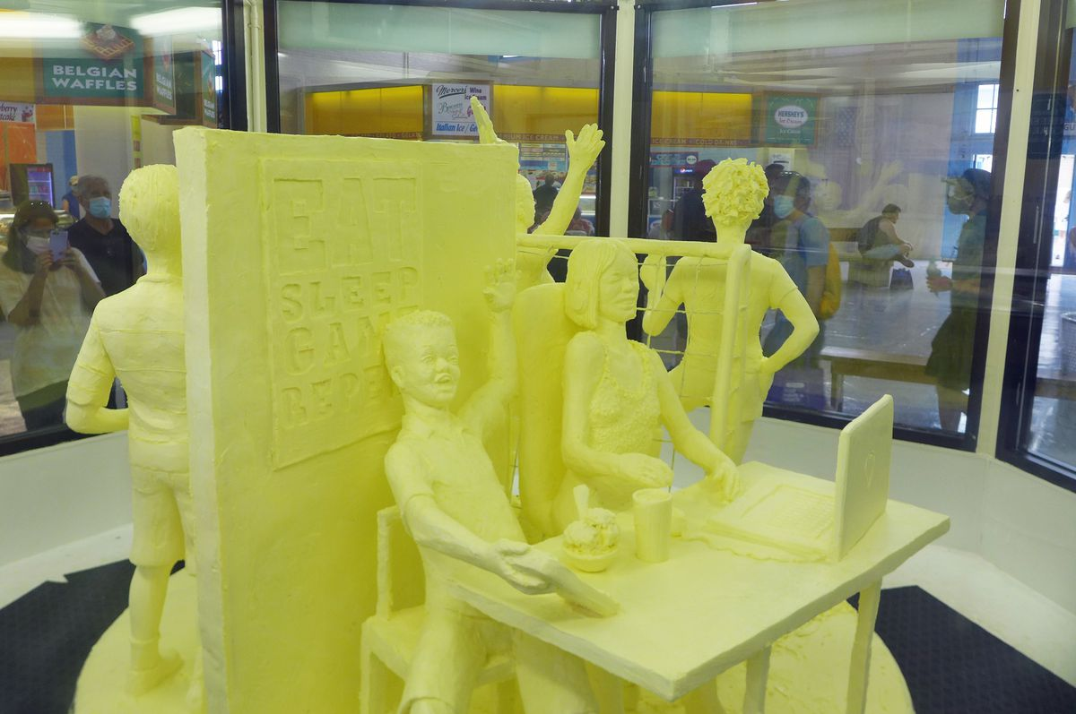 Four schoolkids molded out of butter.