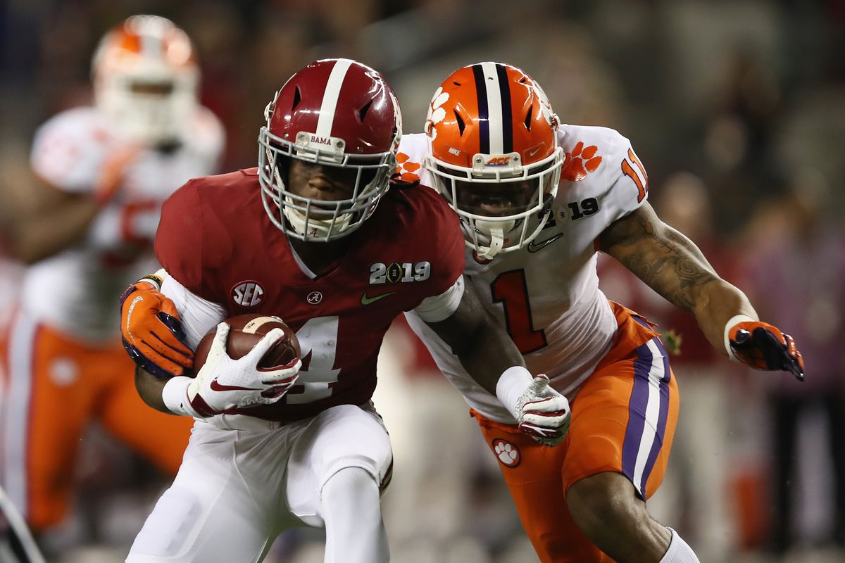 Jerry Jeudy #4 of the Alabama Crimson Tide is pursued by Isaiah Simmons #11 of the Clemson Tigers in the CFP National Championship presented by AT&T at Levi's Stadium on January 7, 2019 in Santa Clara, California.