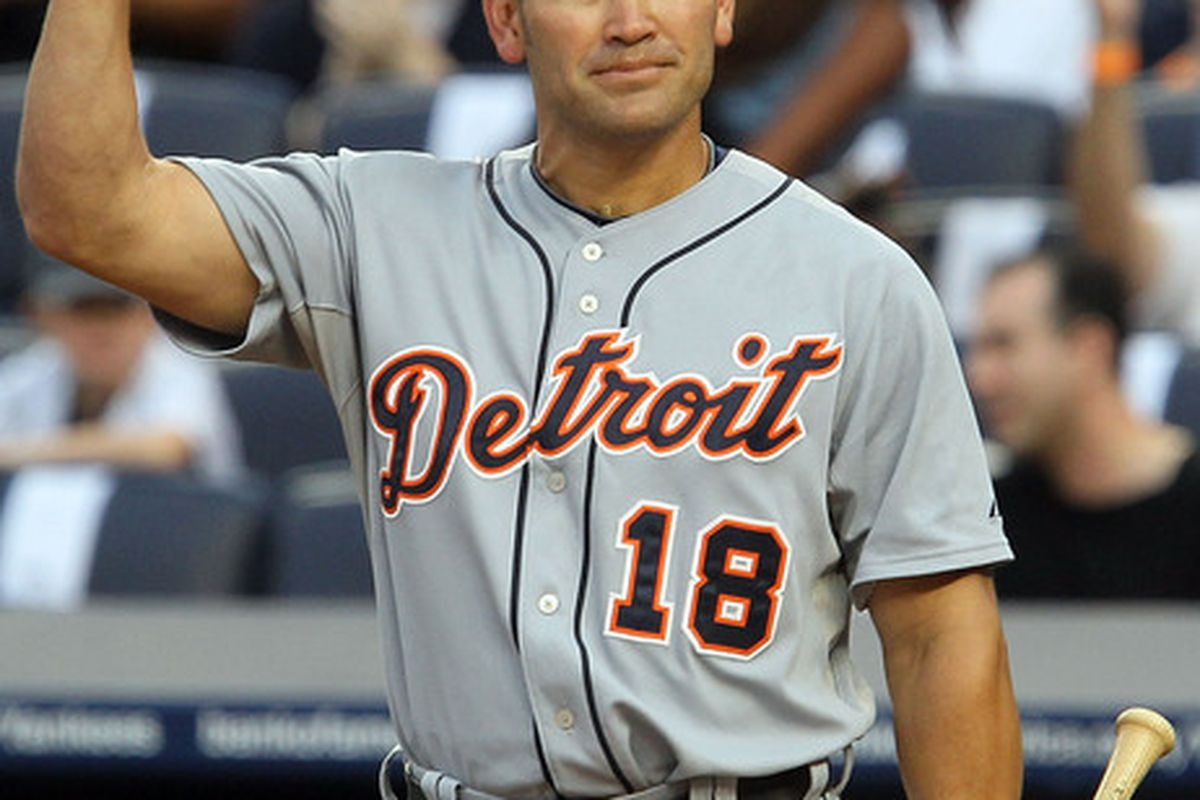 Johnny Damon of the Detroit Tigers salutes the crowd prior to his first at bat against the New York Yankees on August 16 2010 at Yankee Stadium in the Bronx borough of New York City.  (Photo by Jim McIsaac/Getty Images)