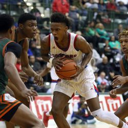 Curie's Dajuan Gordon (3) drives through the Morgan Park defense in their 65-60 CPS championship victory 65-60 at Chicago State University in Chicago, Sunday, February 17, 2019. | Kevin Tanaka/For the Sun Times