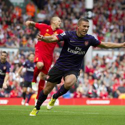 Arsenal's Lukas Podolski, right, celebrates after scoring against Liverpool during their English Premier League soccer match at Anfield Stadium, Liverpool, England, Sunday, Sept. 2, 2012.