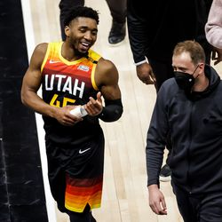 Utah Jazz guard Donovan Mitchell (45) and guard Joe Ingles (2) talk as they leave the court after the Jazz won over the against the Oklahoma City Thunder at Vivint Smart Home Arena in Salt Lake City on Tuesday, April 13, 2021.