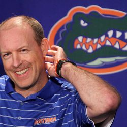 In this photo taken March 13, 2012m Florida offensive coordinator Brent Pease talks with media during an NCAA college football press conference in Gainesville, Fla. Pease is apologizing for using obscenities after being caught on camera obviously swearing during the Gators' season opener.