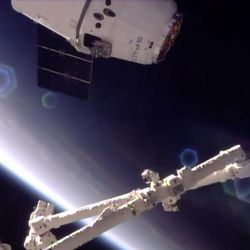 In this frame from NASA TV, a SpaceX Dragon approaches the International Space Station on Monday, June 5, 2017, making an unprecedented second trip to the orbiting outpost. The Dragon supply ship, recycled following a 2014 flight, was launched from Florida on Saturday. (NASA TV via AP)