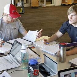 Students Eric Gausseres, left, Adrian Feolo and others study at The University of Utah's J. Willard Marriott Library in Salt Lake City Wednesday, Jan. 21, 2015.