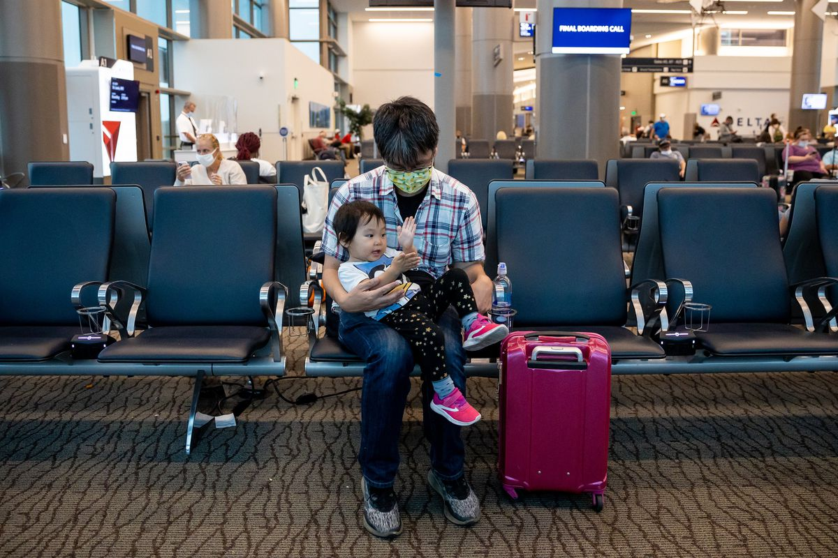 Kazuhide Aikoh plays with his son, Lino, 2, before their flight to San Jose, Calif., at Salt Lake City International Airport in Salt Lake City on Wednesday, Aug. 18, 2021.