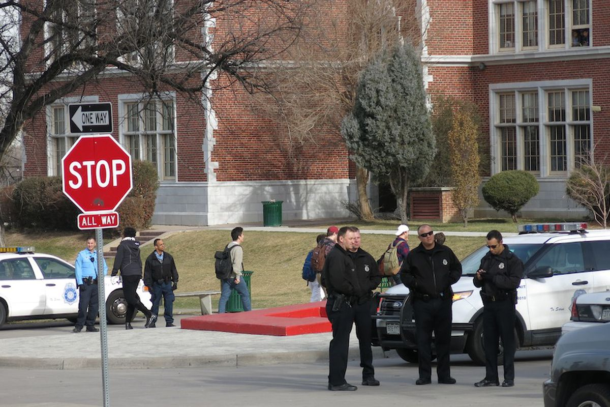 Denver police at East High School supervise a protest led by South students.