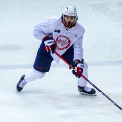 Michal Kempny skates with the puck at Capitals morning skate.