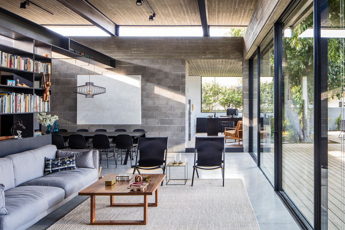 Concrete House Offers Indoor Outdoor Living Among Fruit