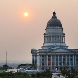 The sun sets behind the state Capitol as smoke engulfs the Wasatch Front on Wednesday, Sept. 6, 2017, as the Western states endure an active fire season.