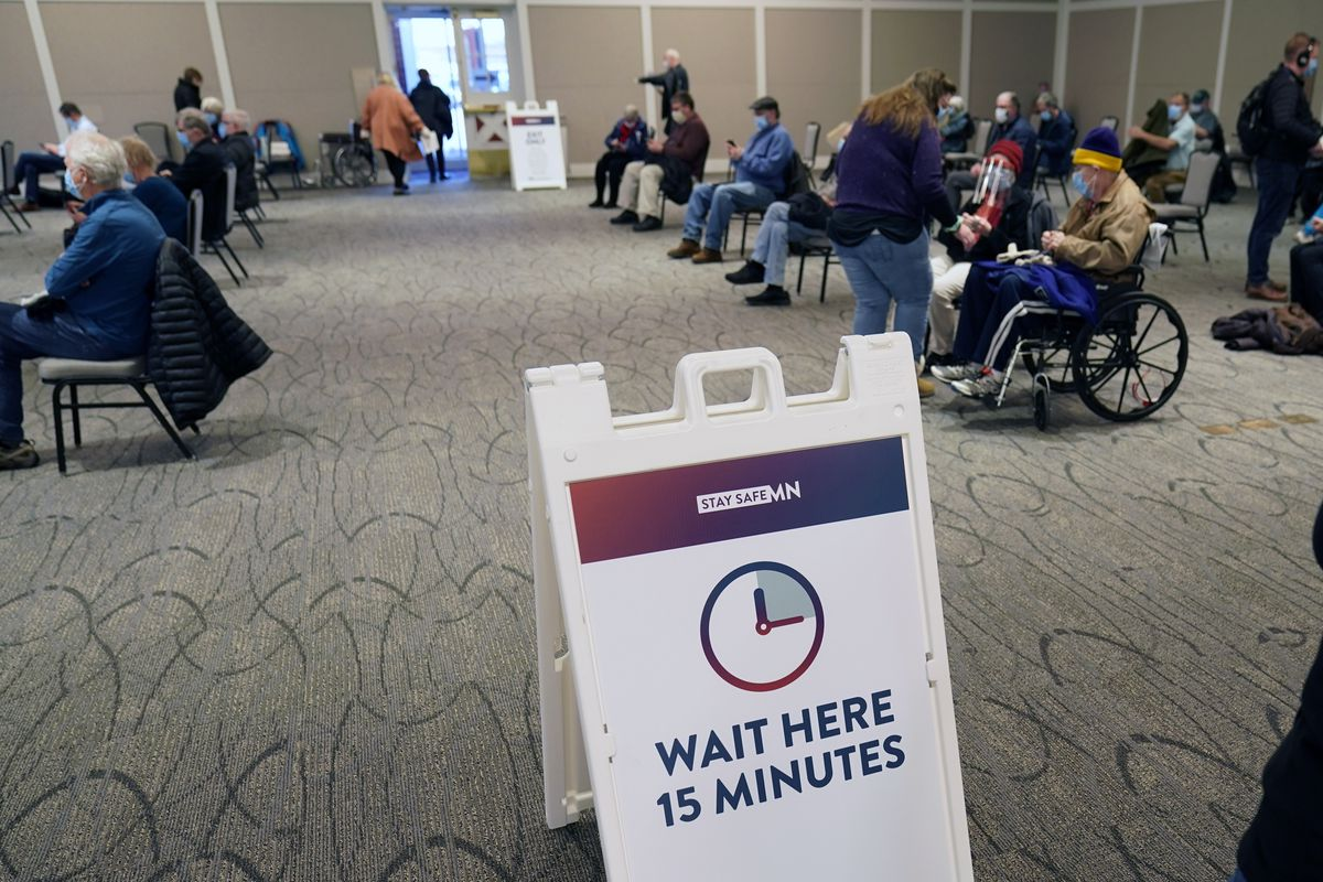 People who received a vaccination, Thursday, Jan. 21, 2021 at the Earle Brown Heritage Center in Brooklyn Center, Minn., wait the 15 minutes before leaving.