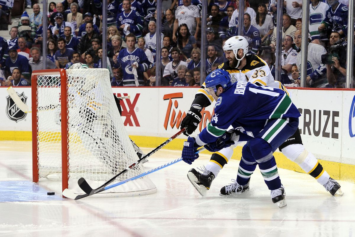 VANCOUVER, BC - JUNE 04:  Alex Burrows #14 of the Vancouver Canucks scores the game-winner in overtime of Game 2 of the Stanley Cup Finals.