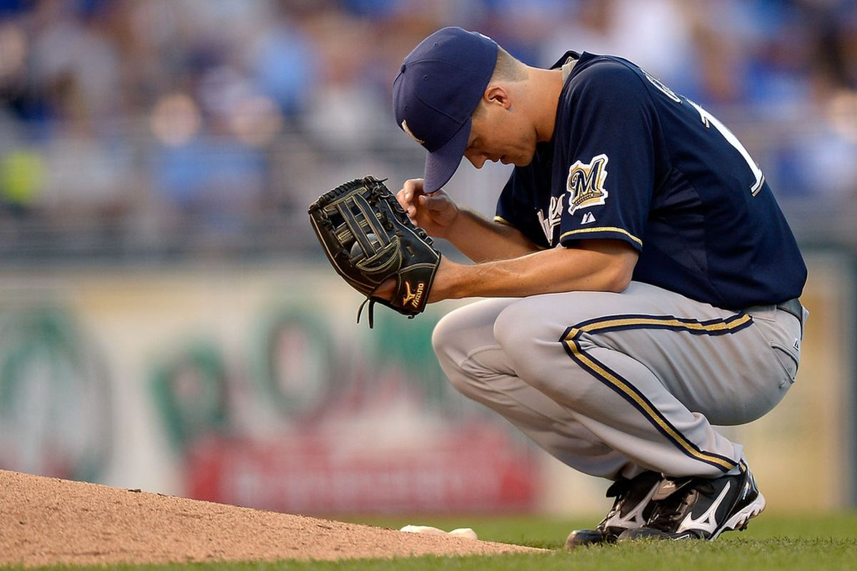 KANSAS CITY, MO - JUNE 12:  Starting pitcher Zack Greinke #13 of the Milwaukee Brewers reacts during the game against the Kansas City Royals on June 12, 2012 at Kauffman Stadium in Kansas City, Missouri.  (Photo by Jamie Squire/Getty Images)