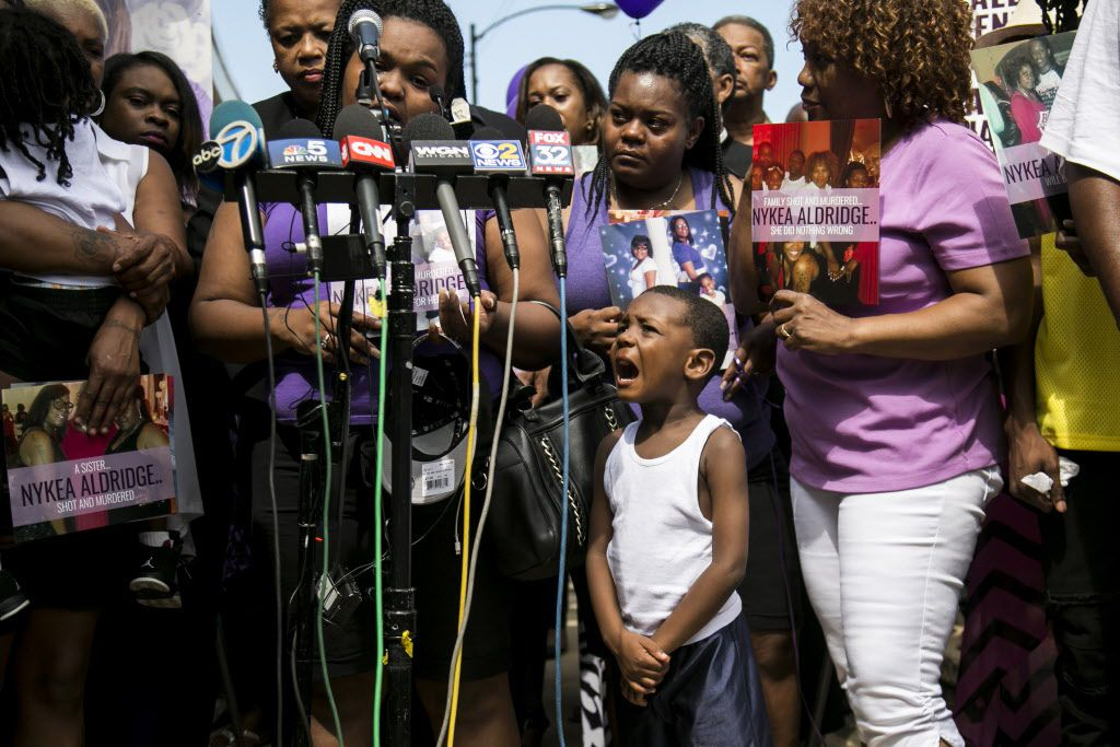 Octavus Crockett, 5, cries as he listens to his mother, Raven Roberts, talk about her aunt Nykea Aldridge during a vigil at the Willie Mae Morris Empowerment Center on Sunday, Aug. 28, 2016.   Ashlee Rezin/Sun-Times