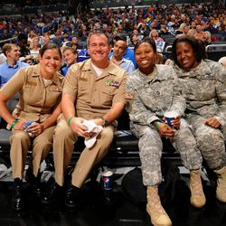 Military personnel sitting courtside at the Magic vs. Suns matchup on November 4 as part of the Magic's Seats for Soldiers Night presented by Harris Corporation.
