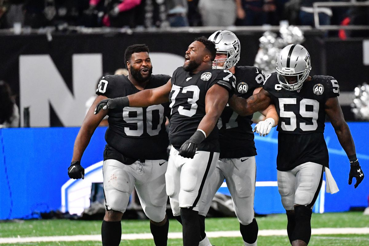 Oakland Raiders defensive tackle Maurice Hurst celebrates a sack of Chicago Bears quarterback Chase Daniel during an NFL International Series game at Tottenham Hotspur Stadium.