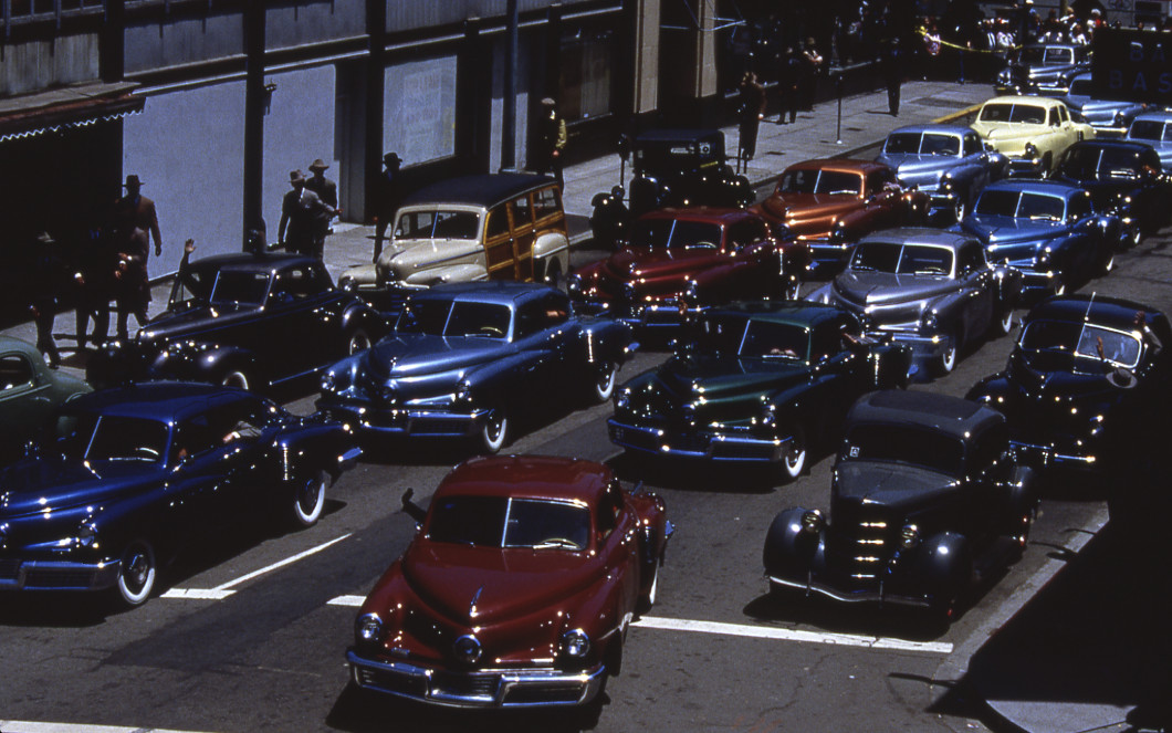 """Tucker 48's crowd a Chicago street after Preston Tucker's acquittal in """"Tucker: A Man and His Dream."""" 
