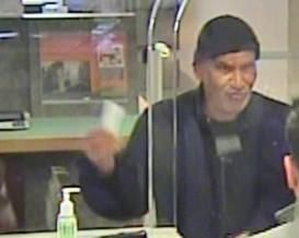 Surveillance image of the suspect in a robbery June 12 at a PNC Bank branch at 2800 W. Armitage Ave.