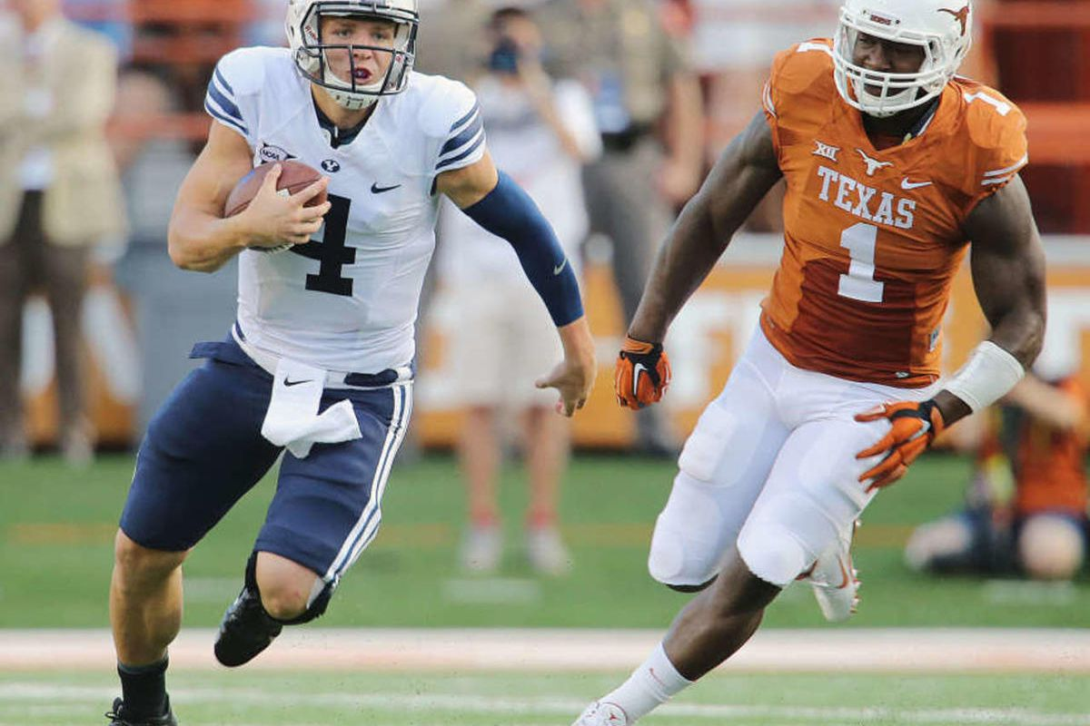 BYU's quarterback Taysom Hill breaks away on a run that was called back as BYU and Texas play Saturday, Sept. 6, 2014, in Austin Texas.