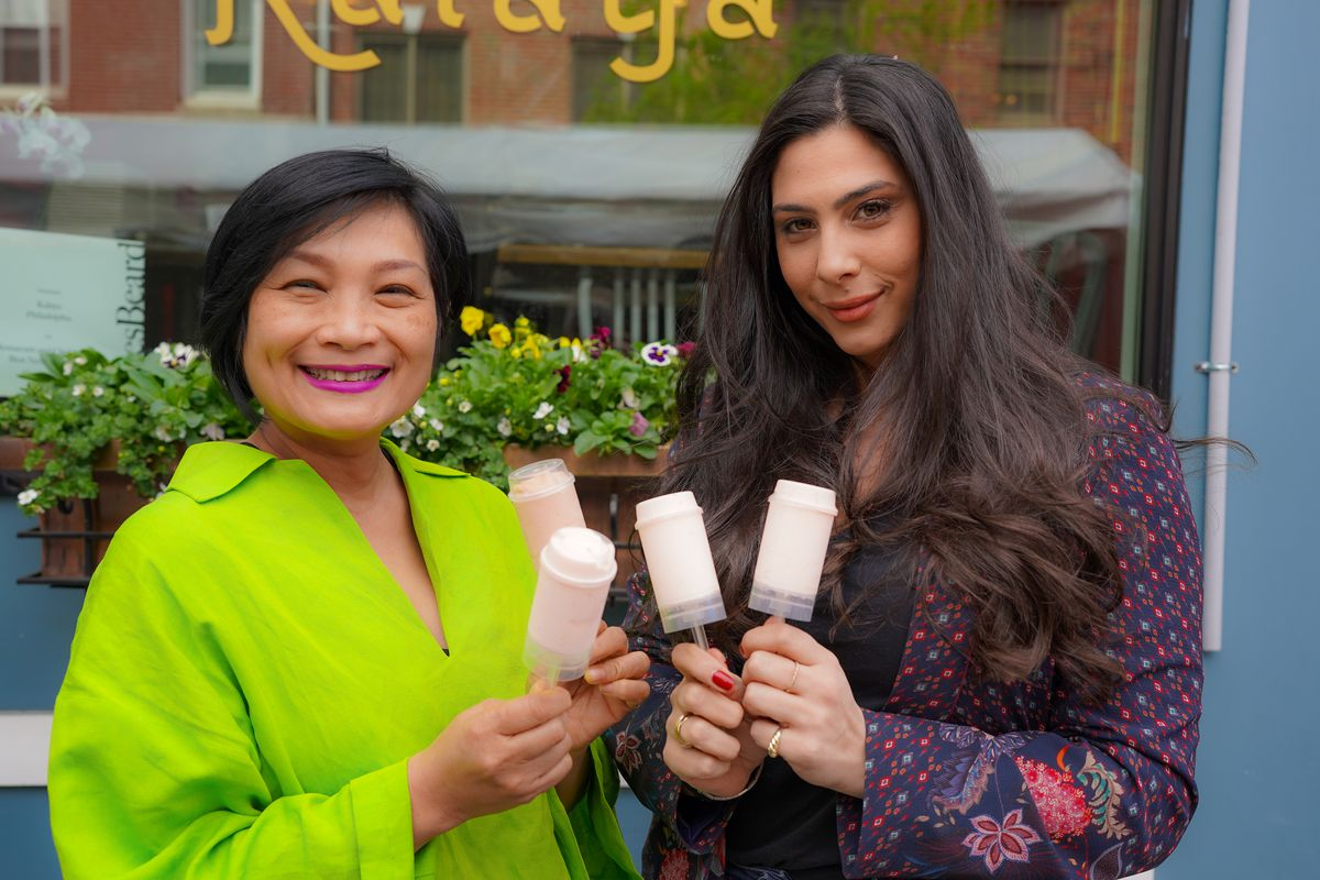 Kalaya Thai Kitchen's Nok Suntaranon and Homemade by Bruno's Janine Bruno standing next to each other holding up ice pops