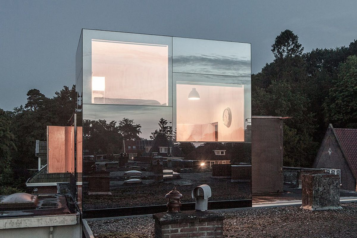 mirrored glass rooftop addition
