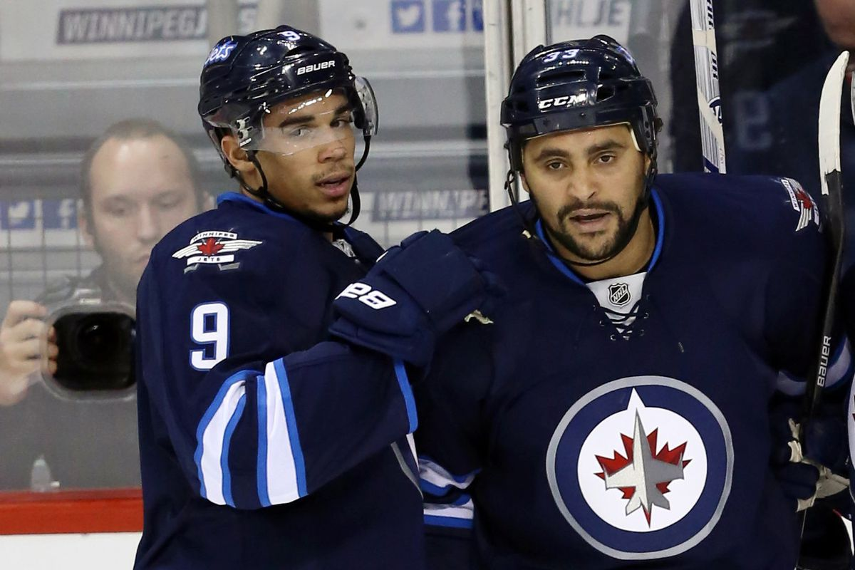 Byfuglien being incredibly self-centered and taking up most of the picture